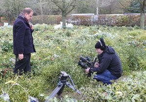 Ben Sidwell of BBC Midlands Today, doing a piece to camera, clutching a little mistletoe sprig