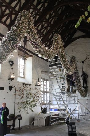 Final stages of hanging the garland